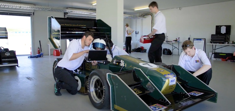 Student building a racing car within a classroom
