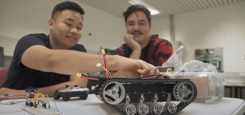 Student building a robot within a classroom