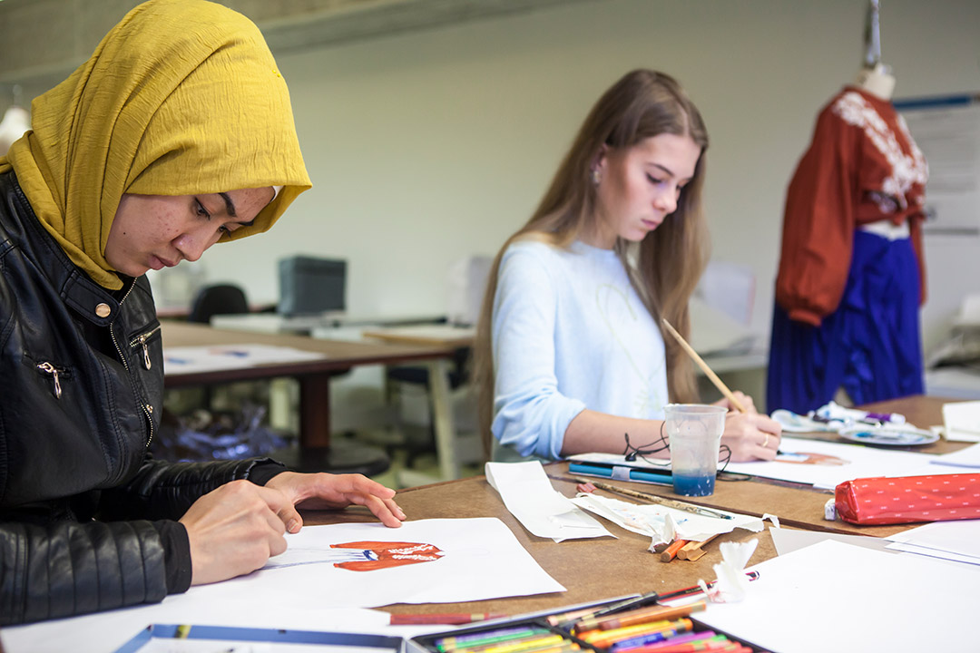 Students drawing in a fashion design room