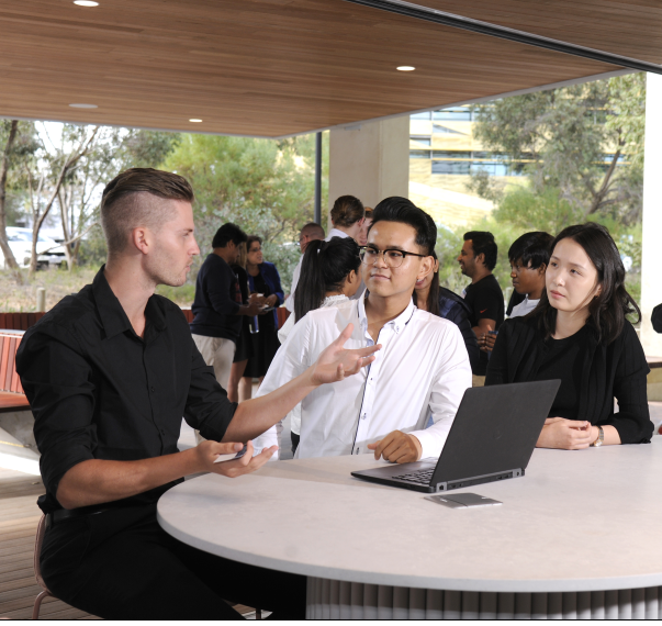 Two students listening to an industry expert